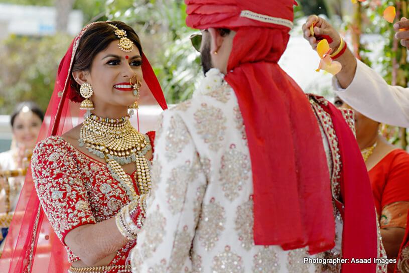 Indian bride and groom looking heavenly