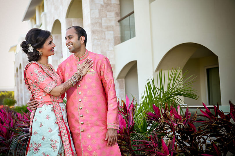 Adorable Indian bride and groom face to face portrait.
