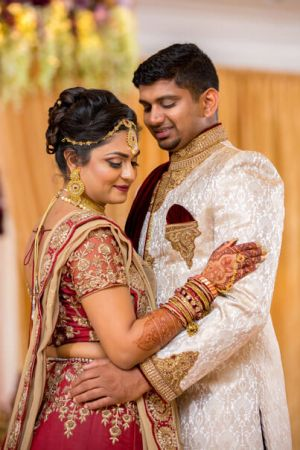 Indian Bride and groom posing for pictures