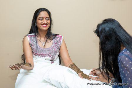 Bride applying mehndi