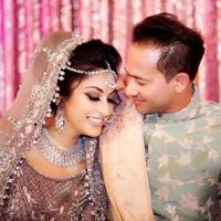 Indian groom admiring bride