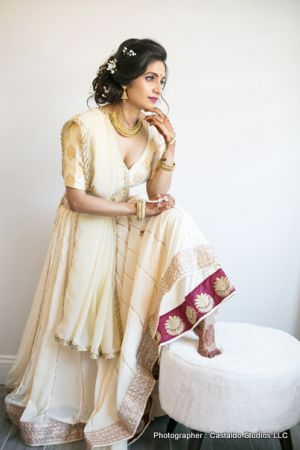 Bride with Mehndi in hands and foot