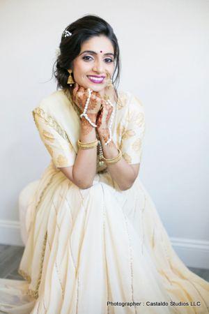 Bride showing her mehndi designs