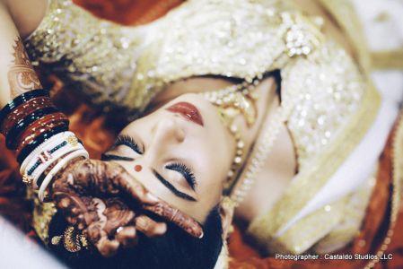 Beautiful bride with mehndi in her hands