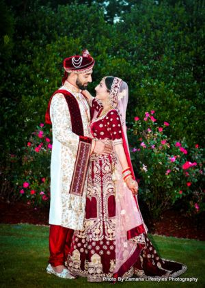 Indian bride and groom posing outside
