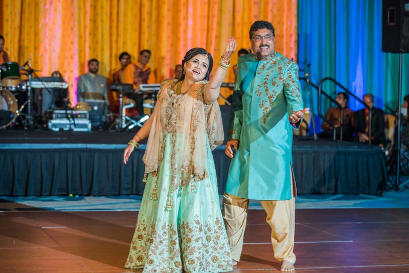 Indian Groom's Father and Mother doing Dance Performance