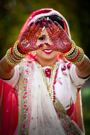 Indian Bride Showing her Mehndi Design