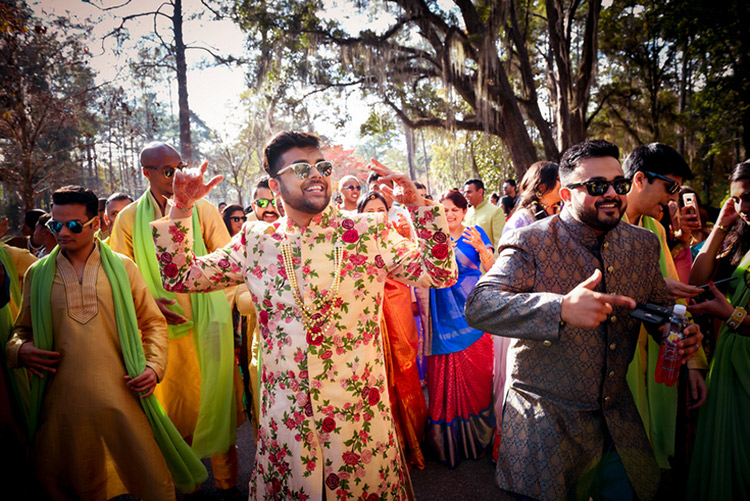 Handsome Indian Groom Dancing with Friends and Family