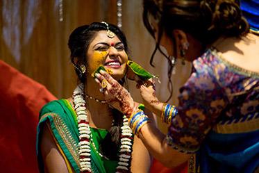 Haldi Ceremony - Painting Yellow Turmaric Paste to Indian Bride