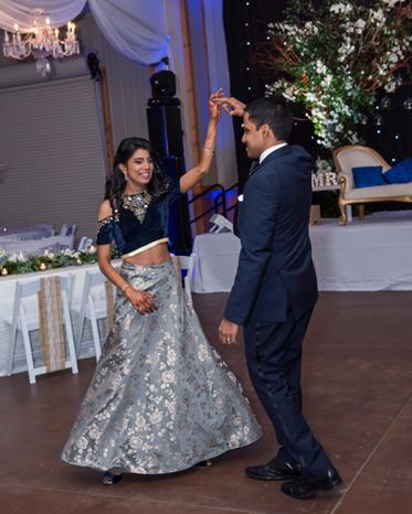 Sweet indian bride dancing with her Groom