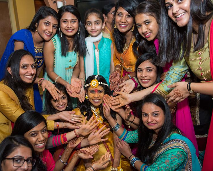 Pre Wedding Haldi Ceremony Applying Haldi on Indian Bride's Face
