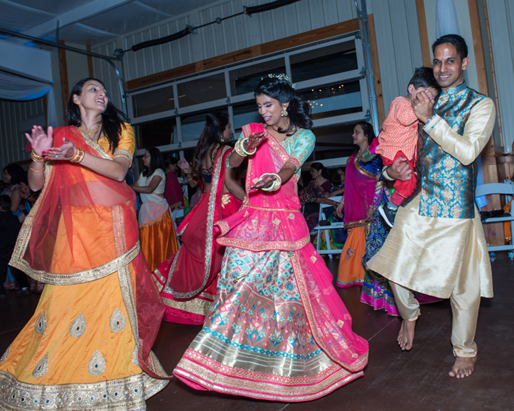 Indian Bride and Groom Dancing at their Sangeet Ceremony