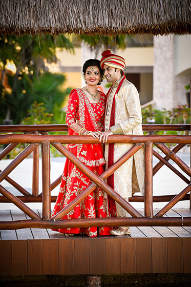 Indian Bride and Groom Hugging Eachother