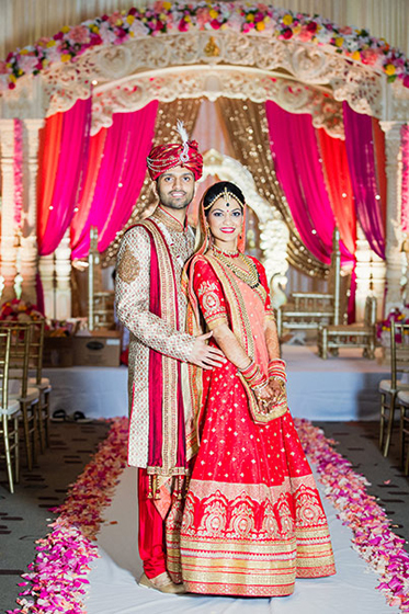 Indian Bride and Groom Capture Under Wedding Mandap