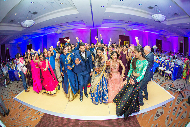 Indian Bride ang Groom Dancing with their Guest Capture