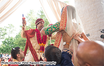 Indian Bride and Groom enjoying Garland Ceremony Photography