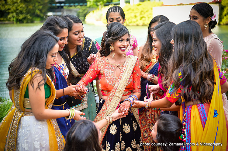Indian Bride Showing her Lovely Mehndi Design to Bridesmaids