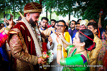 Indian Bride's Mother Welcoming Indian Groom