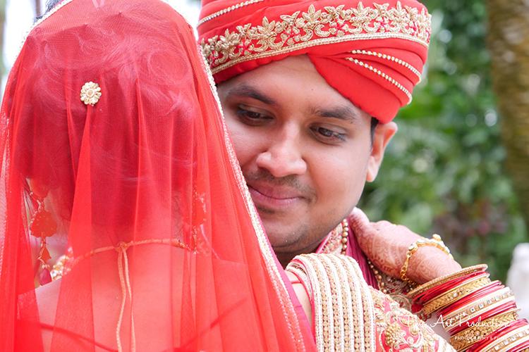 Adorable hug by Indian groom