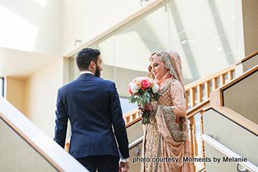 Groom greeting bride with flowers