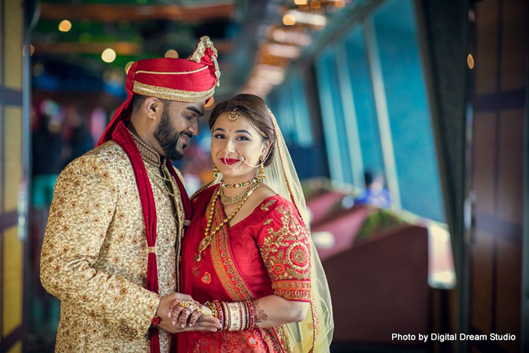 Indian newlyweds posing for elegant pictures