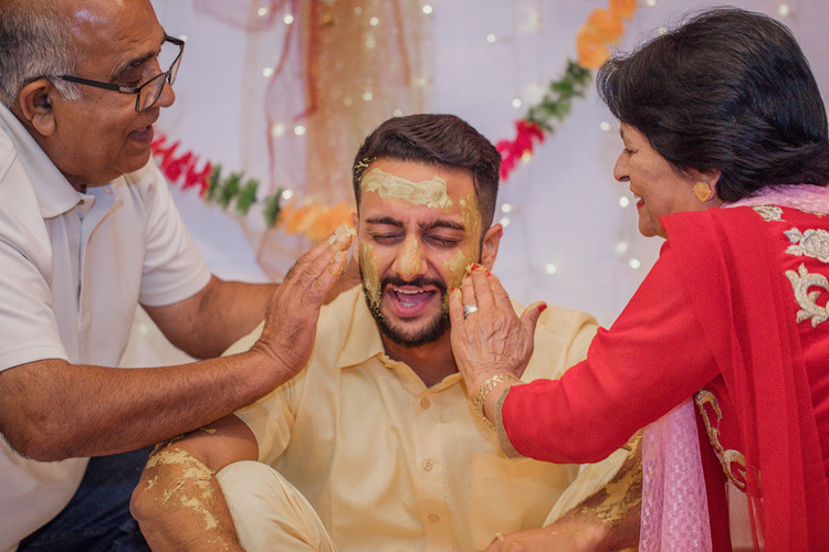 Indian Groom's Parents Applying Haldi on Indian Groom's Face