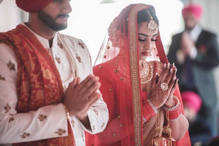 Indian Bride and Groom Taking Blessing of their Guru