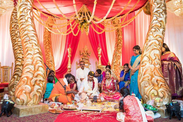Indian Bride and Groom under Beautiful Indian Wedding Mandap