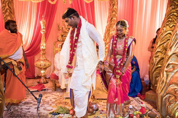 Indian Bride and Groom Walking together holding Hands