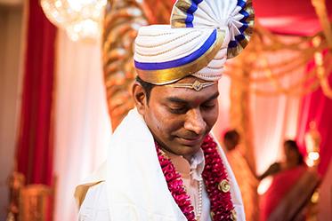 Indian Groom Wearing Turban and Garland