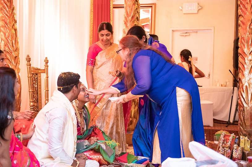Indian Wedding Guest Doing Wedding Ritual