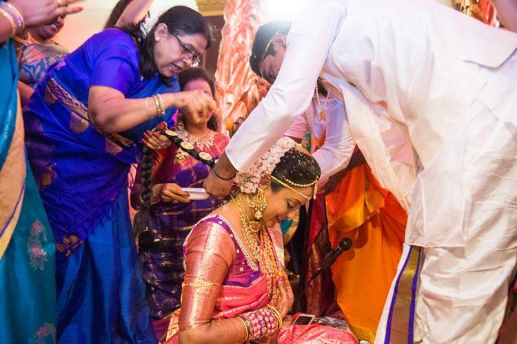 Indian Groom Puts on Bride's Neck Mangalsutra