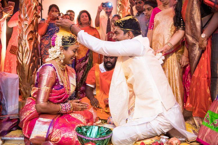 Indian Groom Putting Grains on Bride's Head