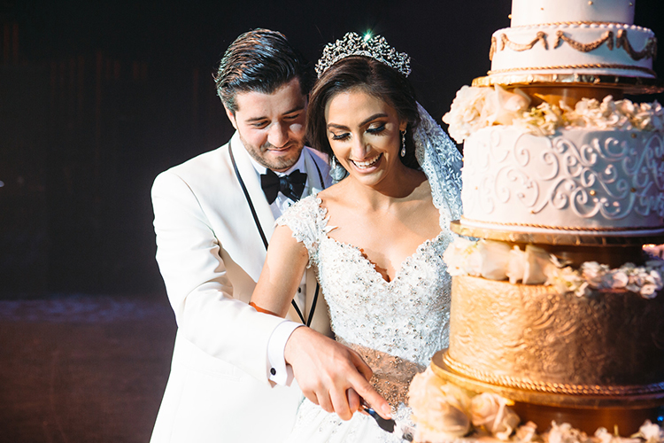 Indian Bride and Groom Cutting Cake