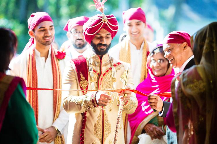 Indian Groom Cutting Ribbin