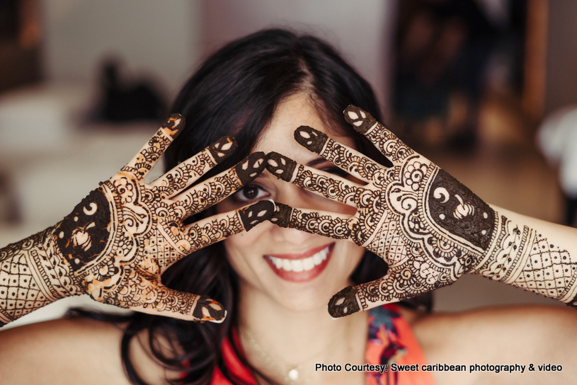 Bride posing with henna on her hands