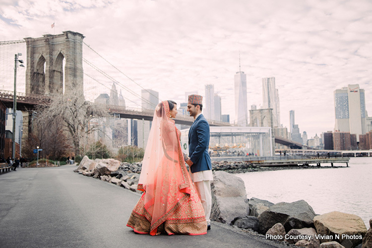 Indian bride and groom looking to each other with love