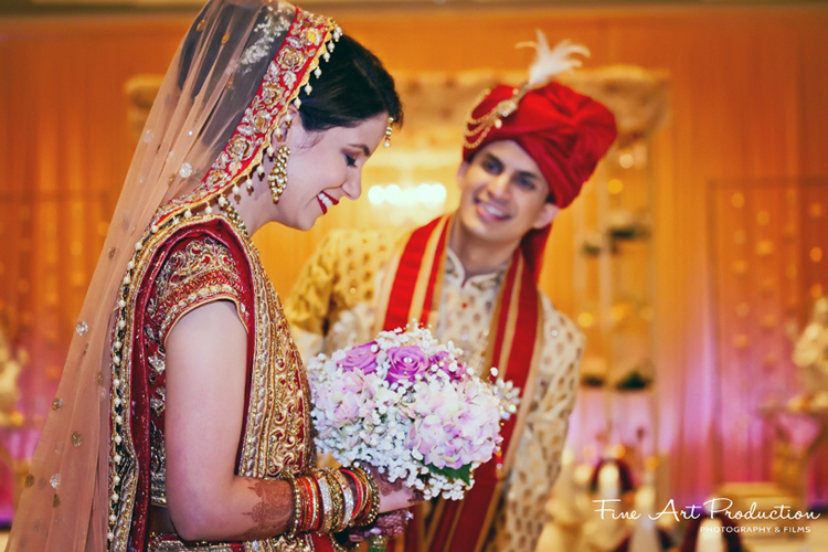 Bride blushing after groom presented her with flowers