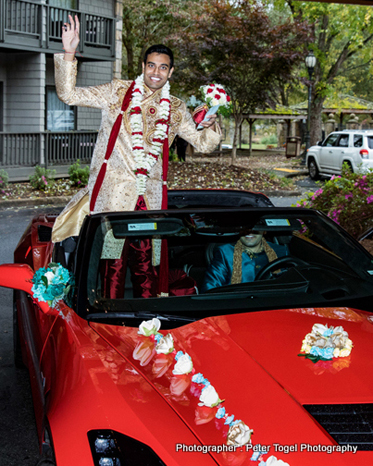 Groom posing in the Car