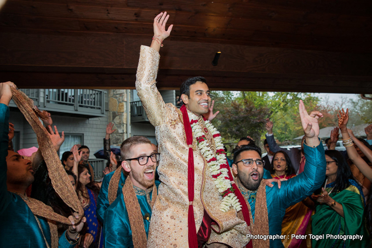 Groom dancing with the friends and family