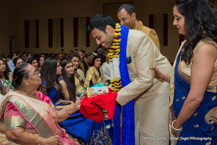 Groom taking blessings from Grand Mother