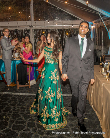 Indian Couple entering at the wedding reception
