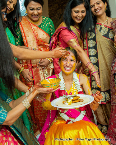 Friends Applying Haldi to Bride