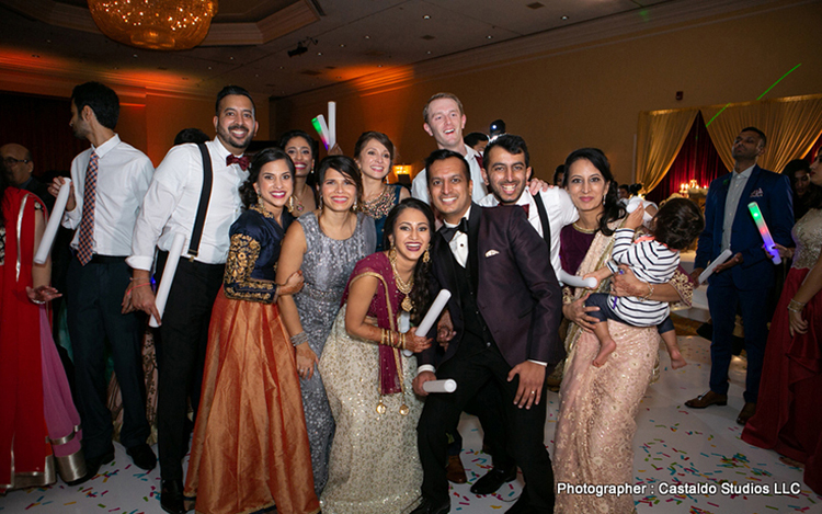 Indian couple with bridesmaids and groomsmen capture at the reception