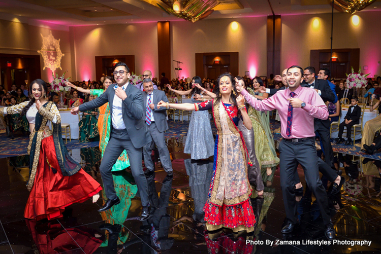 Friends and Family Dancing at the wedding Sangeet