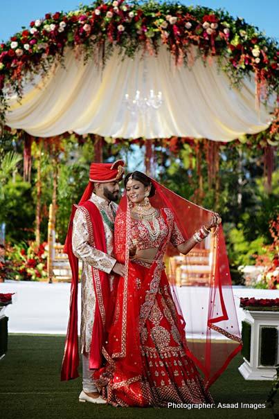 Indian Bride and Groom under Indian wedding Mandap Photoshoot