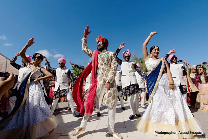 Indian Bride dancing with Indian Bridesmaid and Groomsmen