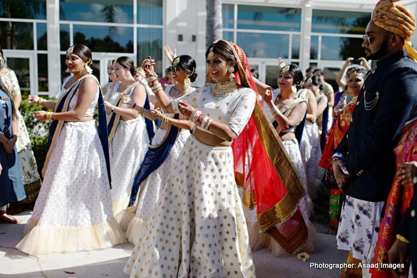 Indian Bride dancing with Baraat Guest