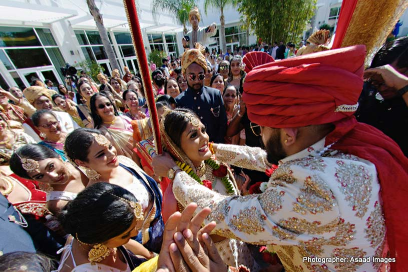 indian groom putting garland to indian bride's neck