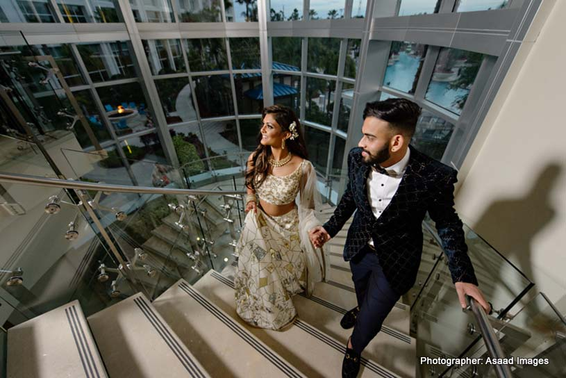 Indian bride and Groom about to take entrance in Reception hall